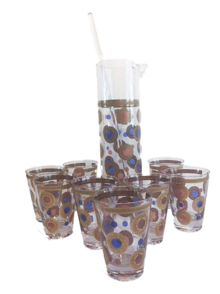 Rare Georges Briard cocktail pitcher and 8 cocktail/martini glasses, along with a stirrer rod. All decorated with pink and blue translucent dots and 22k gold. the larger dots with raised gold circles embossed with flower petals. All signed Georges