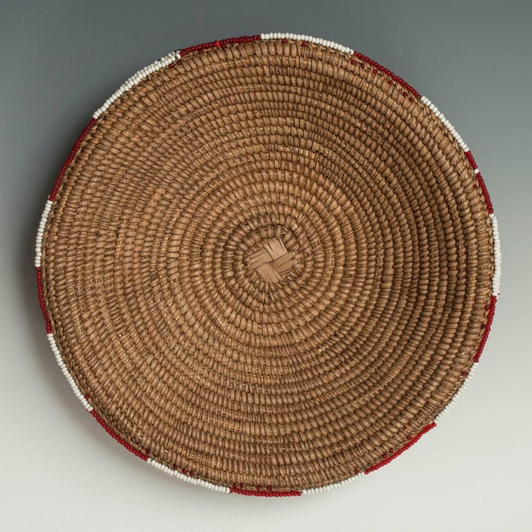Mid-20th century beer pot cover (Imbengi) Zulu People, South Africa  These beaded covers were used over the mouth of a traditional ceramic beet pot, Ukhamba, to protect the sorghum beer from dust and flies. This graphic example is in great