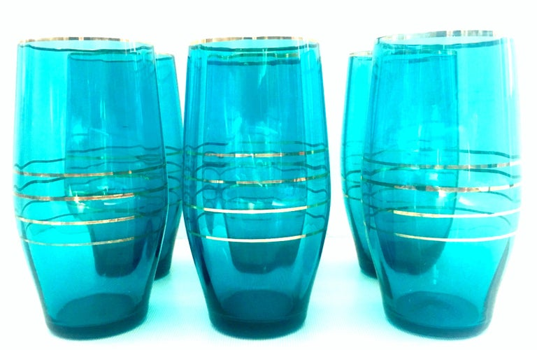 Mid-20th century modern blown glass & 22-karat gold drink glass set of six pieces. These turquoise and 22-karat trim optic blown glass tumblers are a set of six pieces.