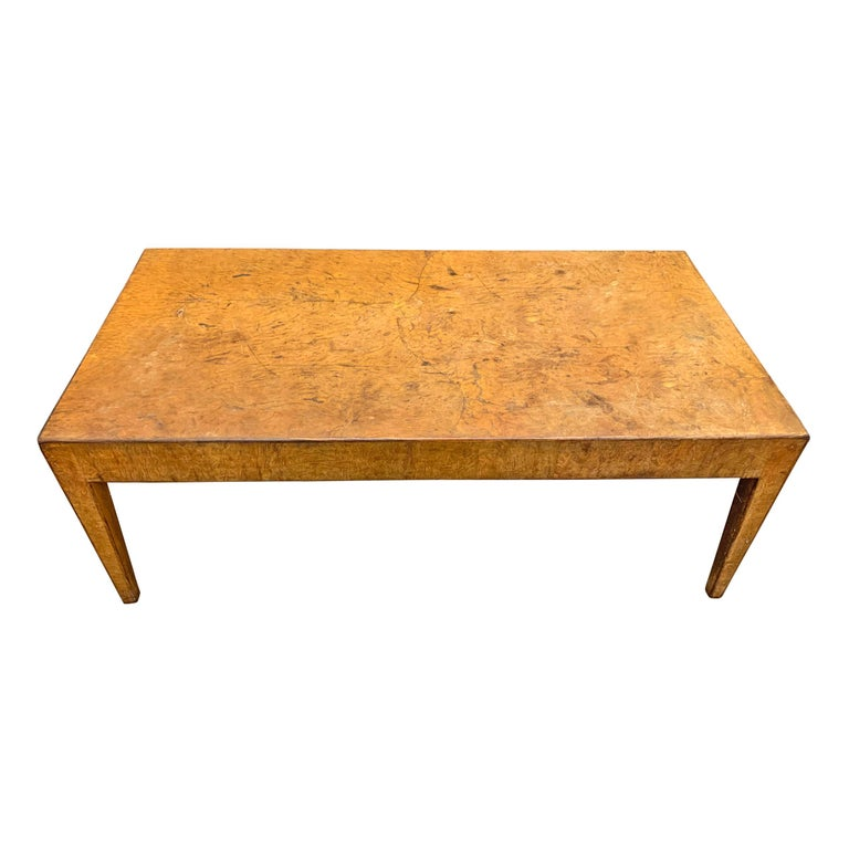 A beautiful mid-20th century Italian burl wood low table with square tapered legs and a thin zebra-wood inlaid band surrounding the top and around each leg.