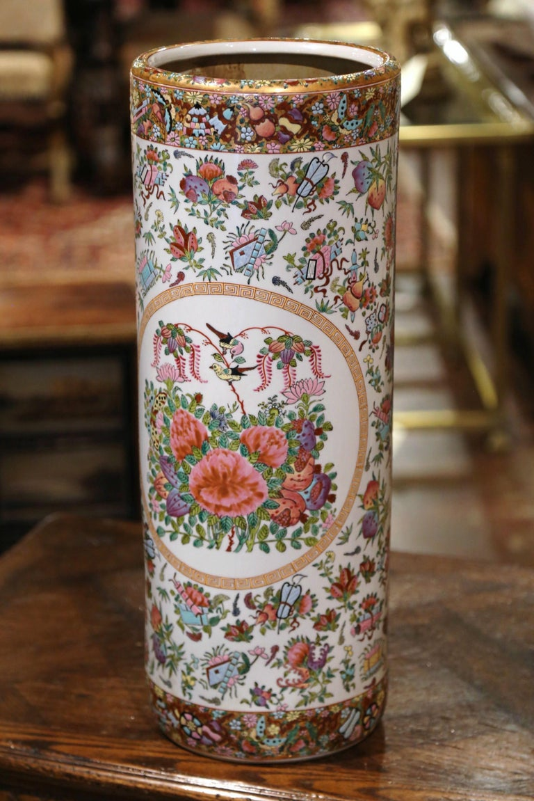 Created in China circa 1950, this large colorful rose medallion stand is round in shape and features hand painted floral reserves with birds and foliate motifs on a white background. The porcelain cane or umbrella stand is in excellent condition