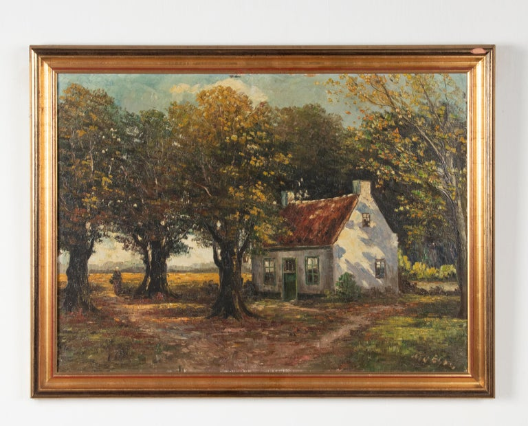 Beautiful and atmospheric painting of a house in a forest on an autumnal sunny day. The sunlight is painted in a beautiful way, you can feel the sun's rays as it were. It is an oil on canvas in a classic gilded wood frame. Point of attention: