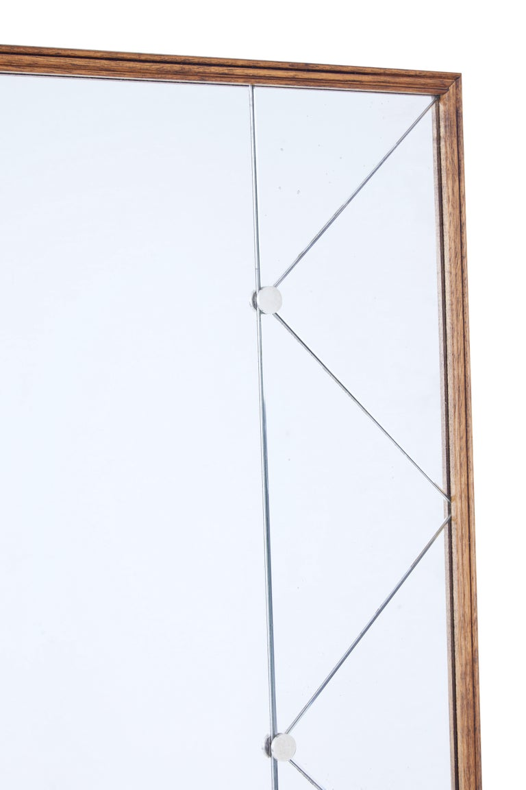 Large and impressive deco inspired mirror, circa 1950.  Thin oak frame, with central mirror flanked either side by diamond and triangle cut mirror.  Mirror segments held in place by steel studs.