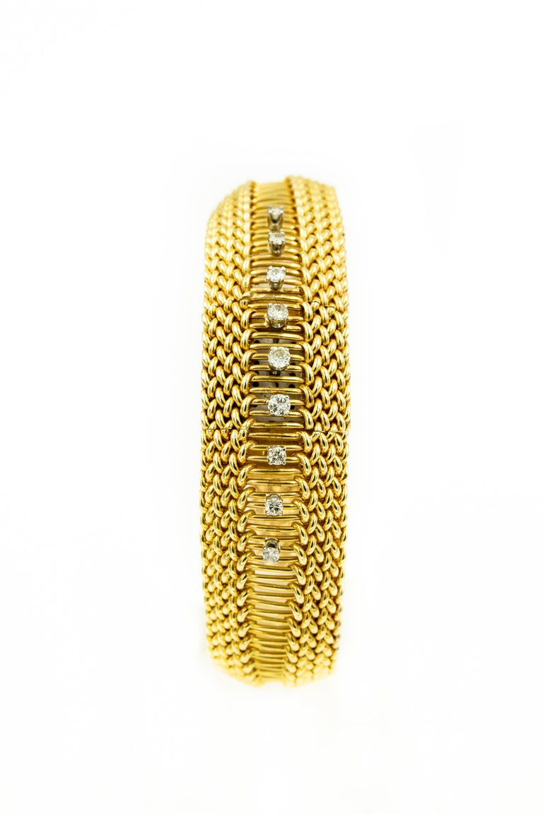 Elegant covered 14k yellow gold woven ladies watch with 9 prong set diamonds going in a line from top to bottom.  The approximate total diamond weight is .36 carats.  The cover hinges from the side and opens to reveal the dial says which says King's