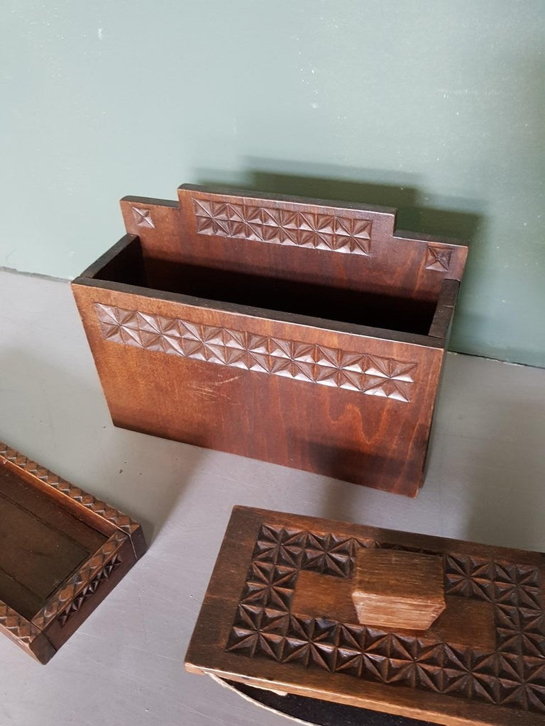 Old Dutch nostalgic carved wooden desk accessories sets consisting of pen tray, letter stand and blotter, mid-20th century.  The measurements are: Depth 7.5 cm/ 2.9 inch. Width 19.5 cm/ 7.6 inch. Height 14 cm/ 5.5 inch.