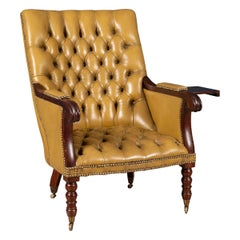 Mid 20th Century English Leather Reading Chair with a Metamorphic Armrest