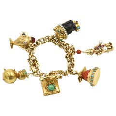 Mid-20th Century Figural Yellow Gold and Gemstone Charm Bracelet
