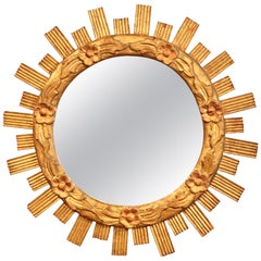 Mid-20th Century French Carved Giltwood Sunburst Mirror with Floral Decor