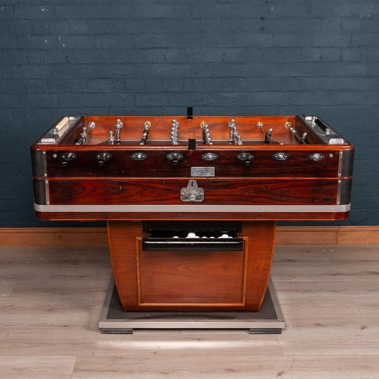 Beautiful and fully restored French table football game, mid-20th century. Painted and varnished wood and chromium plated and other metals, each side with four wooden-handled rods, and mounted with metal ashtrays, the footballers of painted white