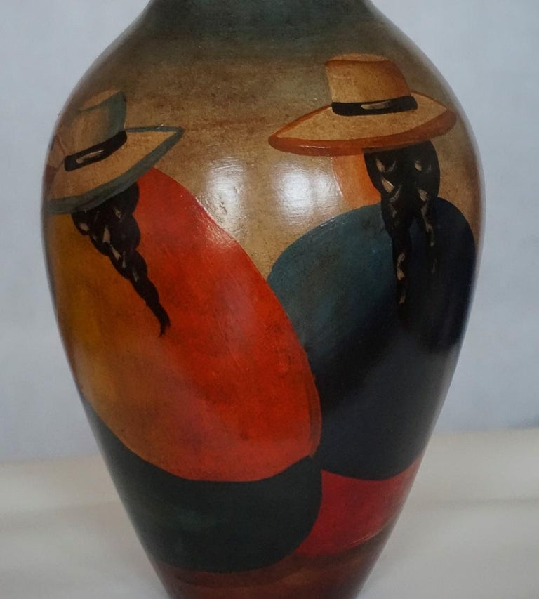 Mid-20th century handcrafted terracotta jar or vase, Peruvian Folk Art painting featuring people silhouettes.
