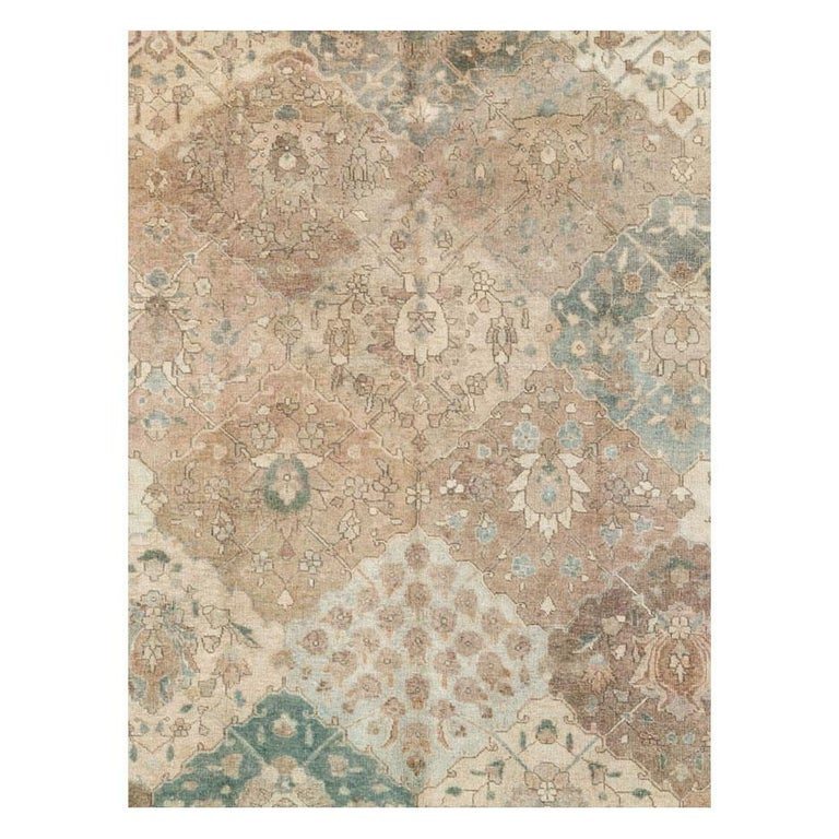 A vintage Persian Tabriz room size rug with a classic garden design in cream and neutral tones handmade during the mid-20th century.  Measures: 9' 5