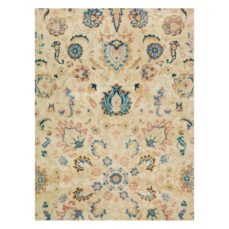 A vintage Persian Tabriz room size rug handmade during the mid-20th century.  Measures: 9' 5