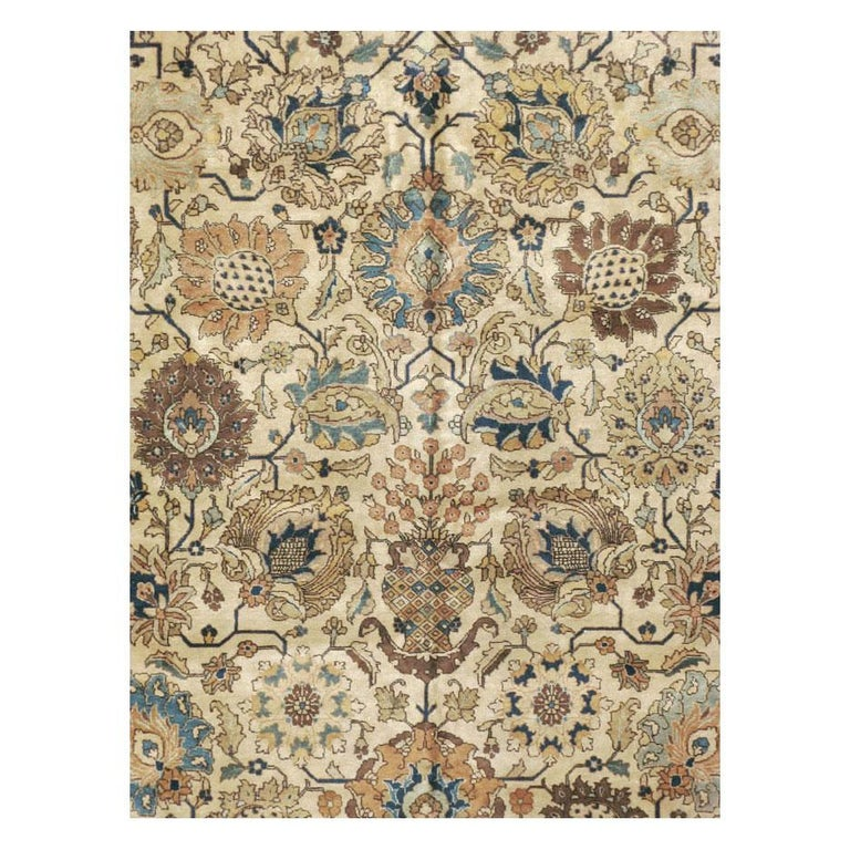 A vintage Persian Tabriz room size rug handmade during the mid-20th century.  Measures: 9' 6