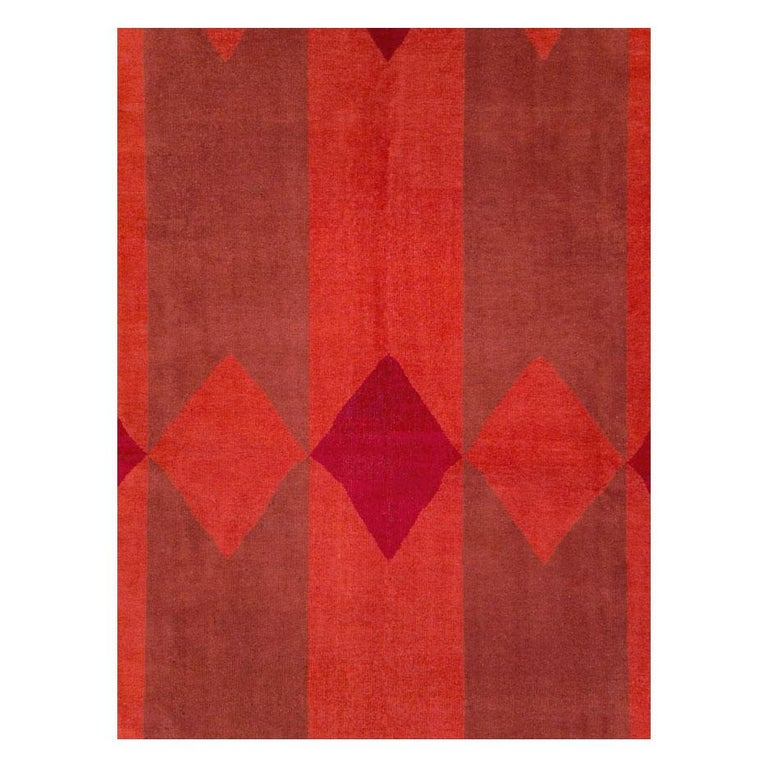 A vintage Turkish Art Deco custom commissioned large room size carpet in the borderless modern style handmade during the mid-20th century. Multiple shades of red create the pole and diamond design.  Measures: 10' 7