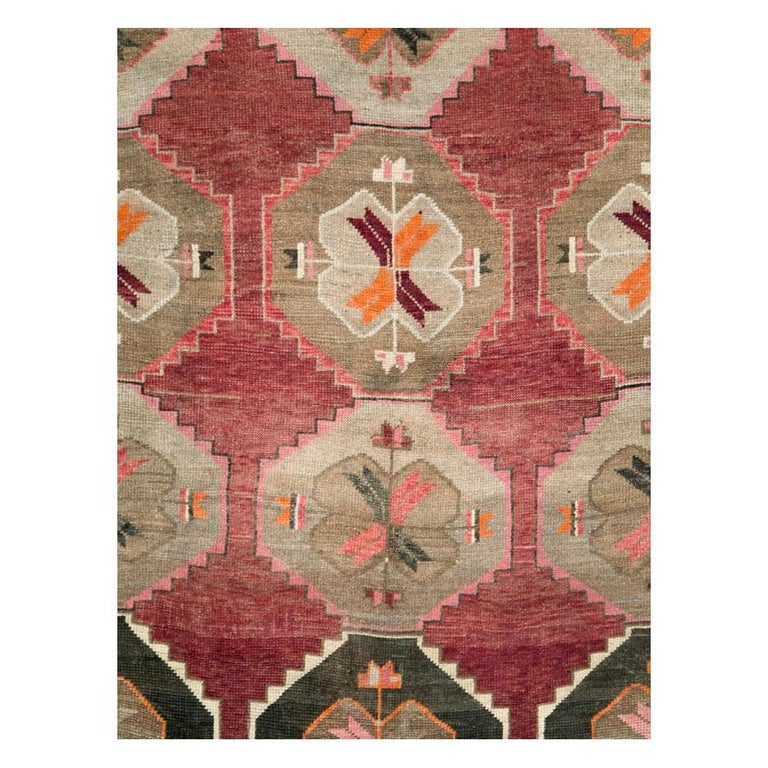A vintage Turkish Anatolian room size rug in long and narrow gallery format handmade during the mid-20th century with a geometric tribal design.  Measures: 7' 1
