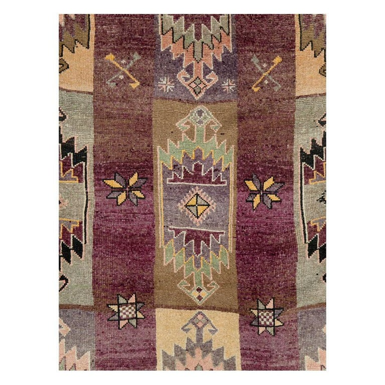 A vintage Turkish Anatolian long and narrow gallery rug handmade during the mid-20th century with a geometric tribal design.  Measures: 6' 2