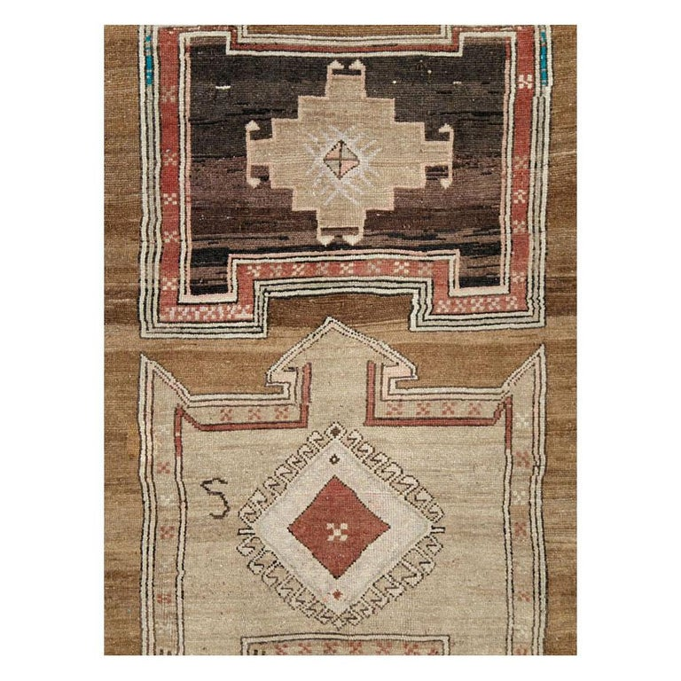 A vintage Turkish Anatolian room size rug handmade during the mid-20th century with a geometric tribal design.
