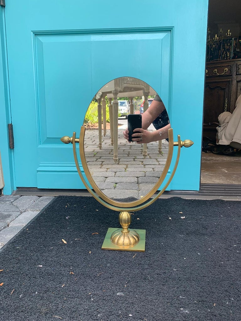 Mid-20th century Italian brass double Sided Vanity Mirror, Attributed to Charles Hollis, circa 1960s Measures: 15.5