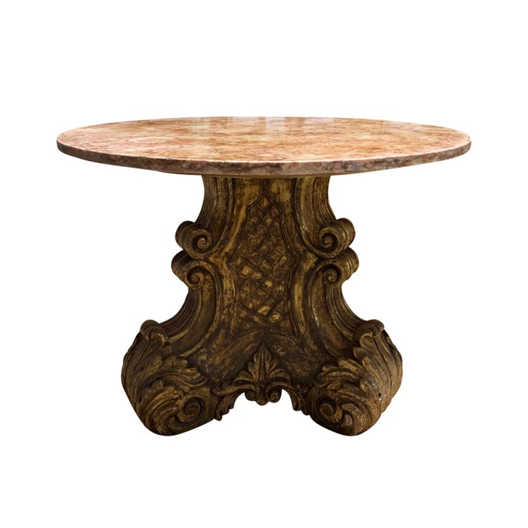 Mid-20th century Italian carved giltwood pedestal table with marble top.
