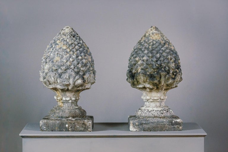 Large pair of weathered cast stone acorn finials, great quality and expected wear and patina. England circa 1950. Priced as a pair.