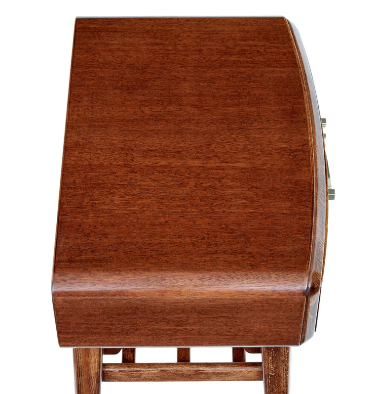 Mid 20th century mahogany bedside table by Bodafors, circa 1950.  Designed by Swedish designer Axel Larsson for Swedish company Bodafors, with makers label on the inside of the drawer.  Shaped flowing lines with single drawer to the front,
