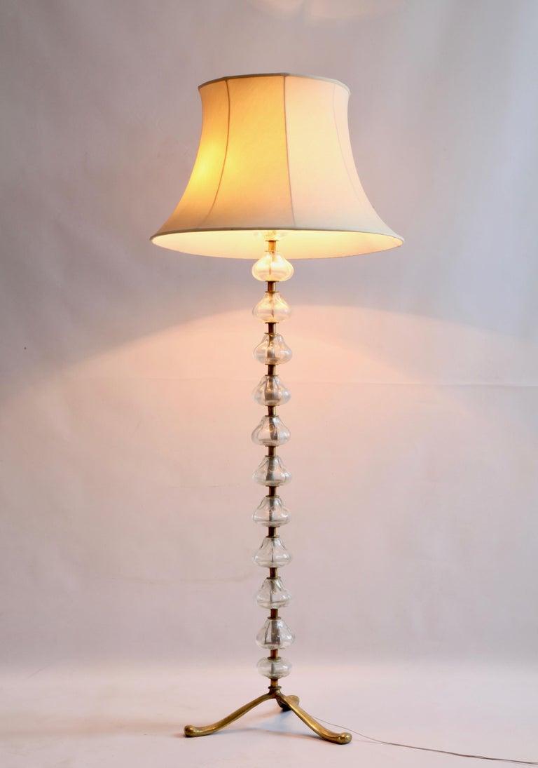 Murano glass floor lamp. Elegant and slick design. Brass frame.