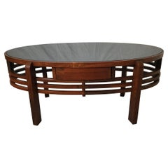 Mid 20th Century Oval Walnut Cocktail Table with Black Glass Top