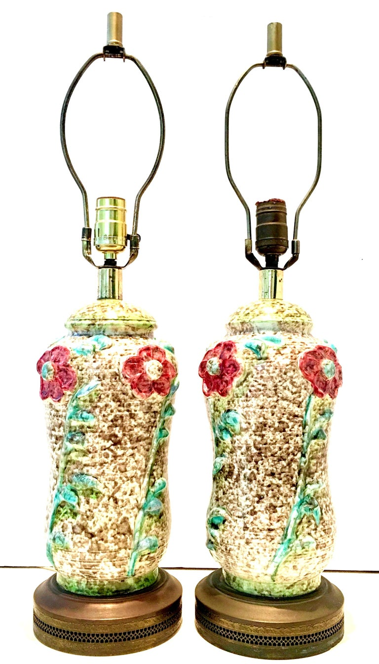 Mid-20th century Art Nouveau pair of ceramic glaze and gilt brass floral motif table lamps. These most unique, whimsical and extraordinary handmade lamps feature a white and wheat ground with textured, raised and incredibly executed floral motif in