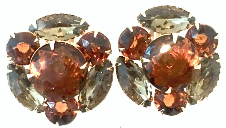 Mid-20th Century Pair Of Gold & Austrian Crystal Dimensional Earrings. These finely crafted gold plate earrings feature fancy prong set brilliant cut and faceted amber and topaz Austrian crystal stones.