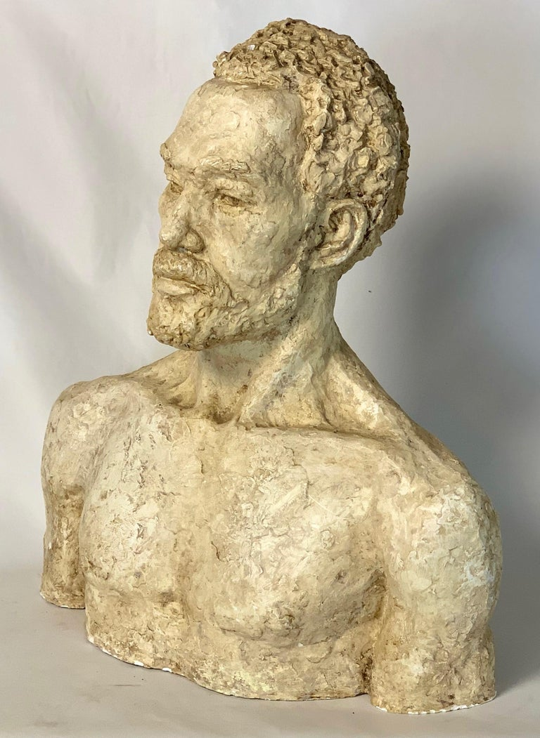 A life sized plaster bust of an African gentleman signed on the back B. Carner.