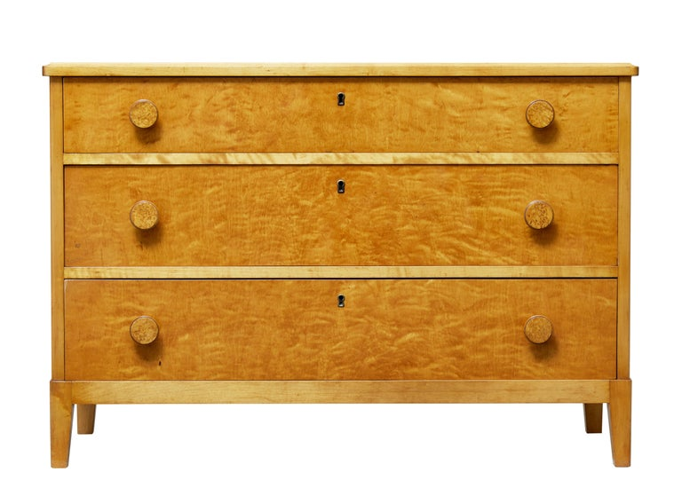 Good quality Swedish chest of drawers, circa 1950.  Fitted with three graduating drawers and burr round knobs.  Rich birch color with fine veneers used. Standing on tapered legs.  Minor surface marks.