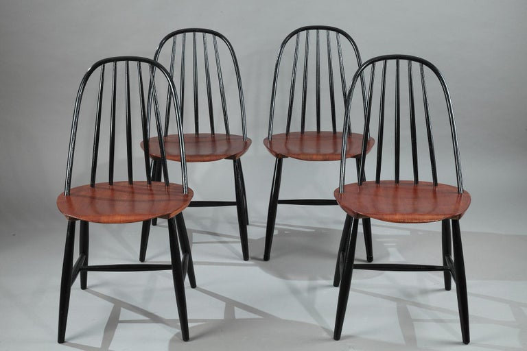 Set of four black lacquered chairs and teak seat, manufactured by Haga Fors, in Sweden,  circa 1950. Dimension: W 17.7 in - D 16.1in - H 33.5in. Dimension: L 45 cm, P 41 cm, H 85 cm.