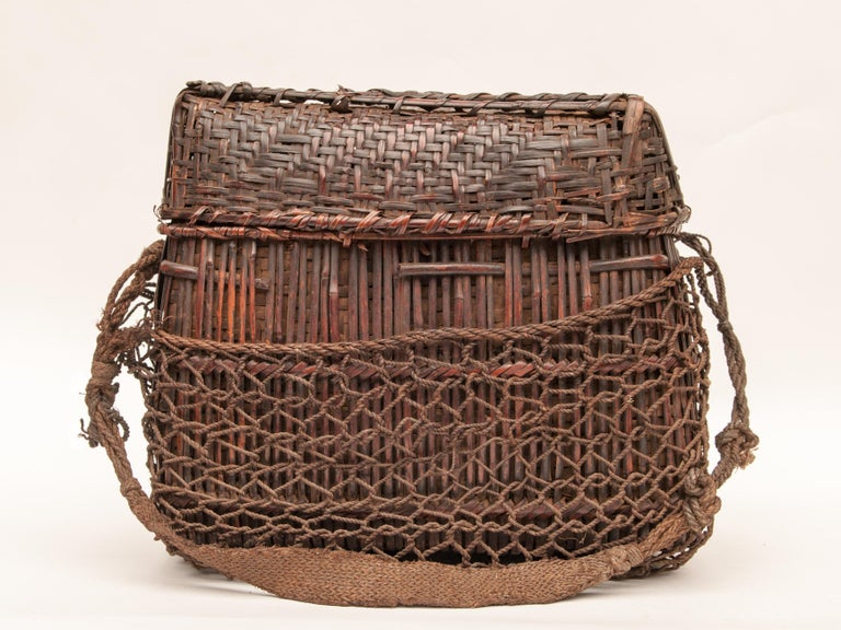 Mid-20th century Shaman Basket with Hand Spun Netting and strap. From the Tamang of north central Nepal.