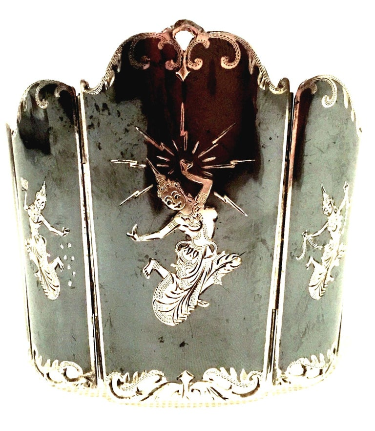 Mid-20th Century Siam Sterling Silver & Niello Enamel Panel Link Bracelet - Signed. This magnificent and finely crafted substantial sterling silver piece features nine graduating panels, hand engraved with sterling silver traditional Asian Figures