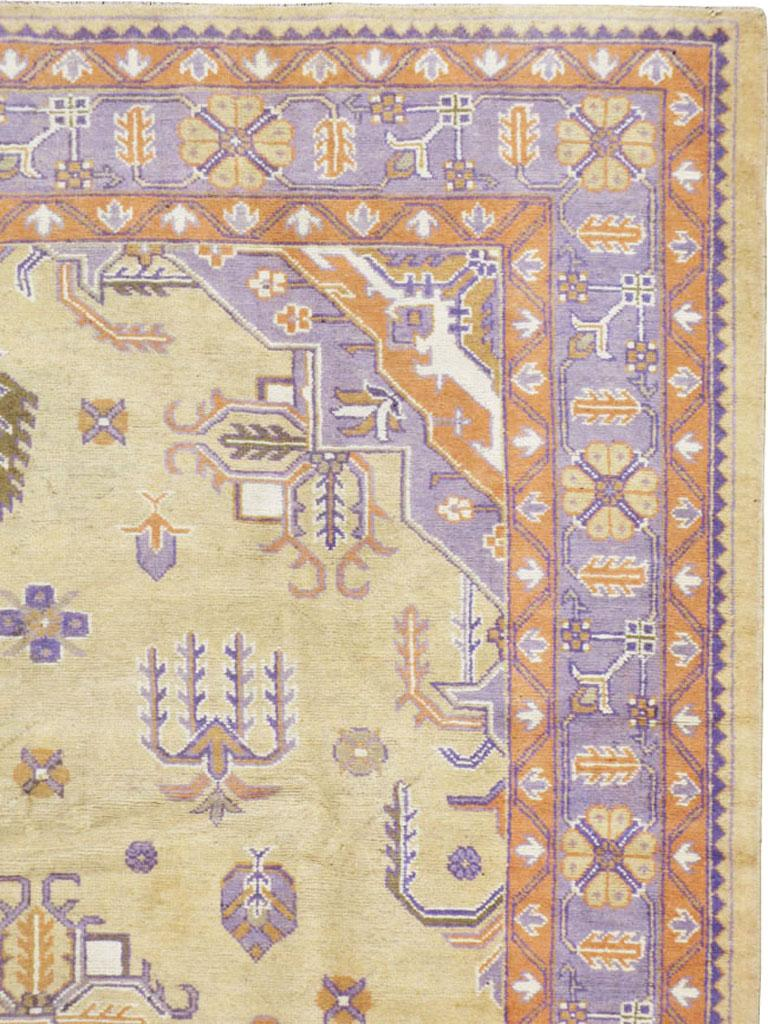 Turkish Mid-20th Century Soft Colored Oushak Carpet in Beige, Purple, and Orange For Sale