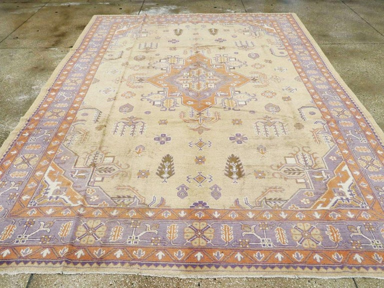 Hand-Knotted Mid-20th Century Soft Colored Oushak Carpet in Beige, Purple, and Orange For Sale