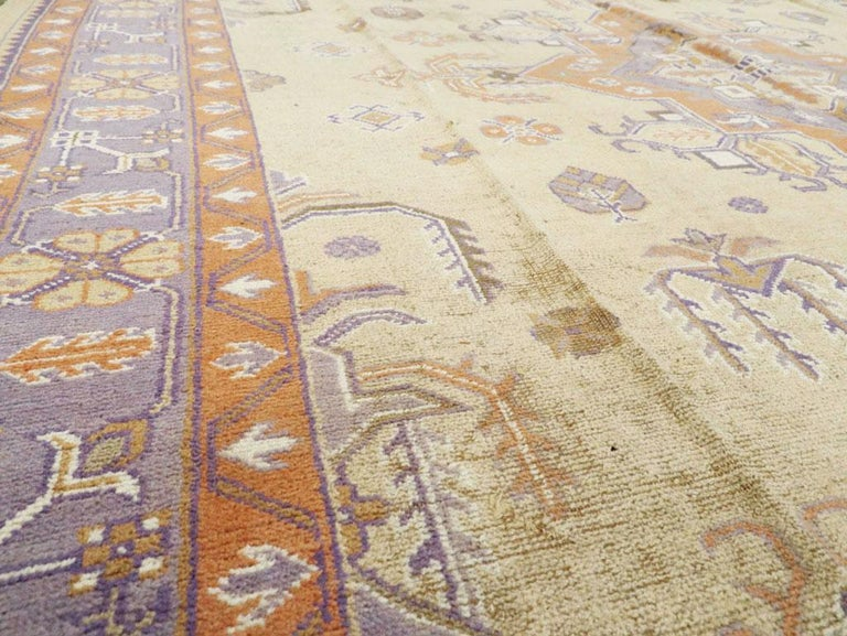 Mid-20th Century Soft Colored Oushak Carpet in Beige, Purple, and Orange In Good Condition For Sale In New York, NY