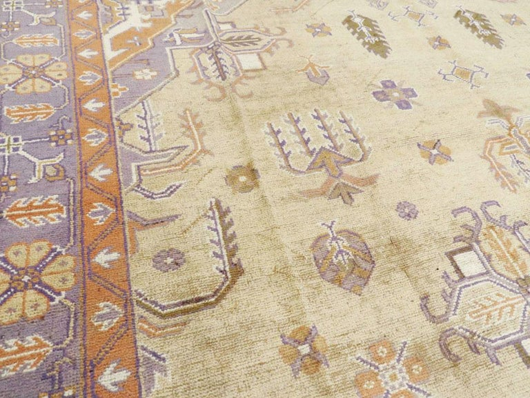Wool Mid-20th Century Soft Colored Oushak Carpet in Beige, Purple, and Orange For Sale