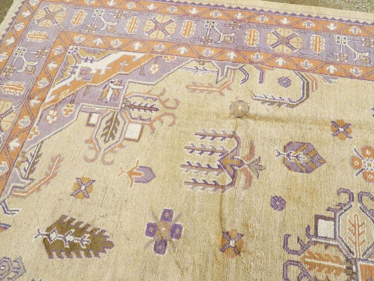 Mid-20th Century Soft Colored Oushak Carpet in Beige, Purple, and Orange For Sale 1