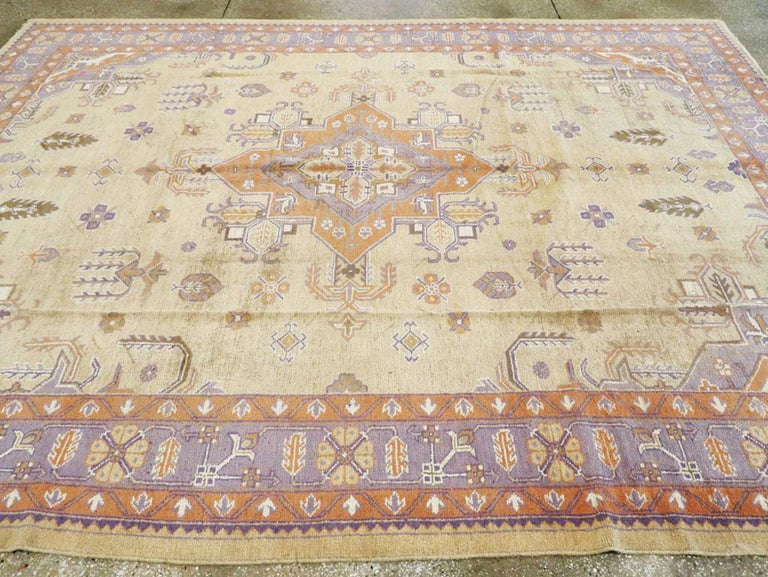 Mid-20th Century Soft Colored Oushak Carpet in Beige, Purple, and Orange For Sale 2