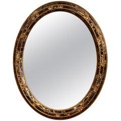 """Mid-20th Century Spanish Black and Gilt Oval Mirror with """"Églomisé"""" Glass"""