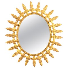 Mid-20th Century Spanish Gilt Iron Oval Sunburst Mirror