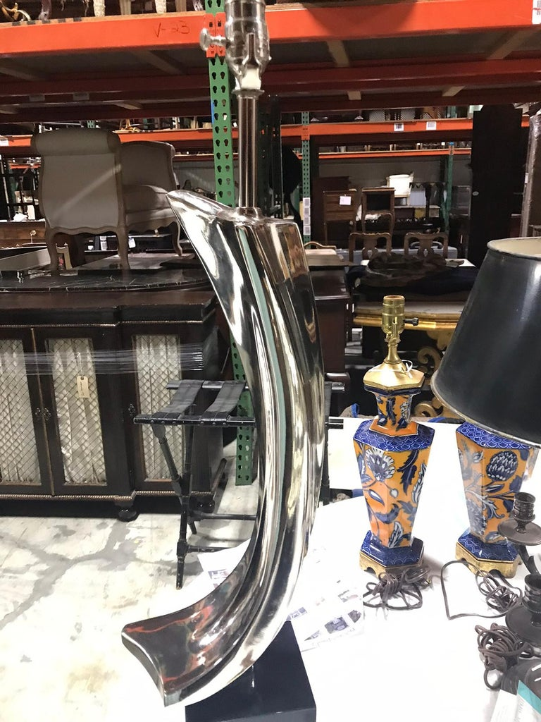 Mid-20th century steel lamp by Laurel Lamp Co. Black wood base New wiring.