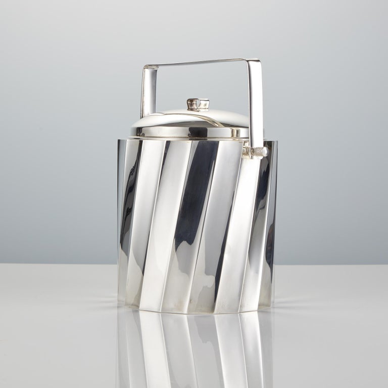 This beautiful quality piece is so well designedespecially the shape which has been formed to give a dynamic mirroredreflection. It would look good either in the bar or dining area & would also make a wonderful gift. Stamped on the base 'Cartier
