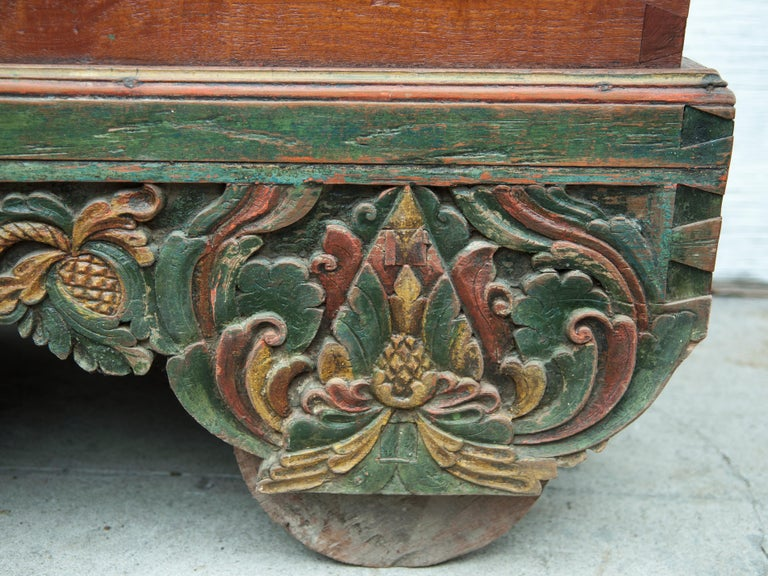 Hand-Crafted Mid-20th Century Teak Chest on Wheels from Java. Original Color and Hardware. For Sale
