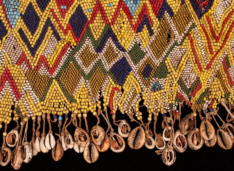 Mid-20th century tribal beaded cache-sex modesty apron (Pikuran), Mandara Mountains, Cameroon  These colorful cache-sex were worn for celebrations, rituals and rites of passage by women who had reached puberty. This is an older piece than many seen