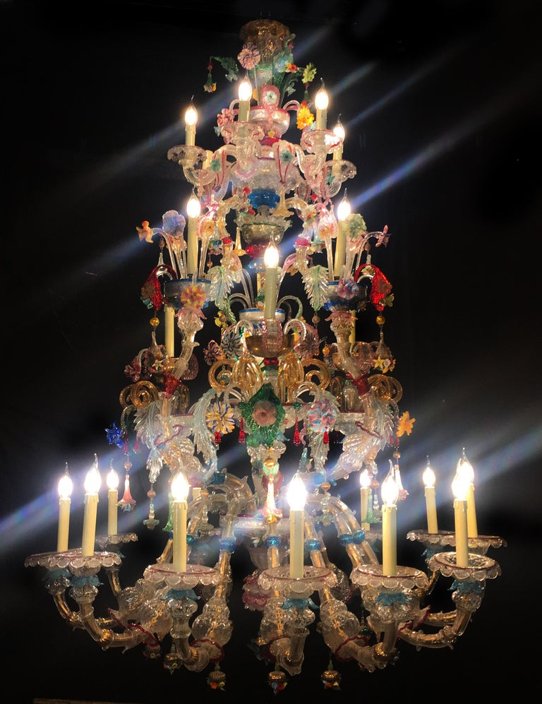 Sumptuous chandelier with 14 flames in very delicate Murano glass blown crystal color embellished with 24-carat gold applications. First half of the 20th century.  Absolute masterpiece of design of the past, characterized from a triumph of