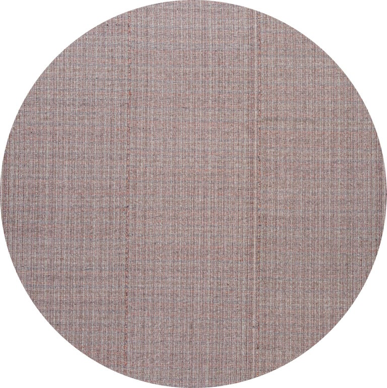 A beautiful mid-20th century flat-weave rug with an all-over gray motif. This piece has fine details, great colors, and a beautiful design. It would be the perfect addition to your home.   This rug measures 10