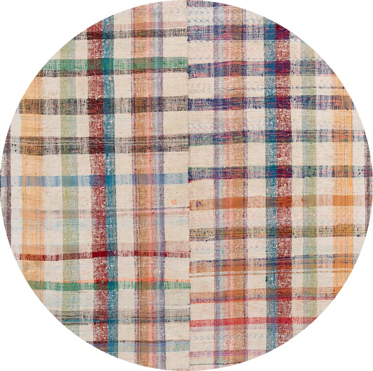 Beautiful vintage flat-weave rug with an all-over multi-color motif. This piece has fine details, great colors, and a beautiful checks design. It would be the perfect addition to your home,   circa 1950.  This rug measures 6'10