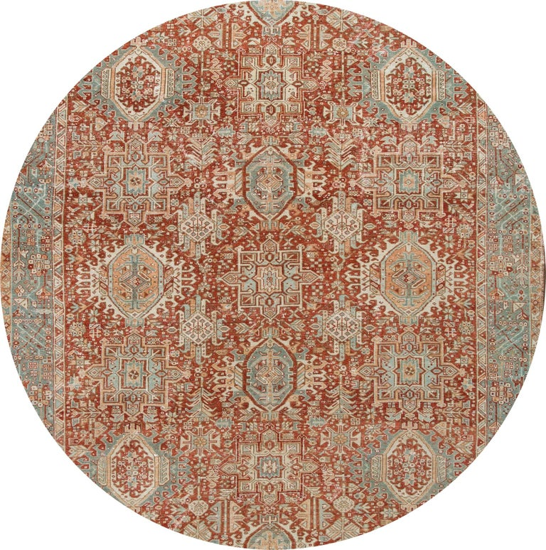 "Beautiful 20th-century vintage Heriz wool rug with a rust field, ivory, blue, and peach accents in the all-over multi-medallion design.  This rug measures: 7'9"" x 11'."